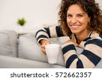 beautiful woman sitting on the... | Shutterstock . vector #572662357