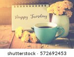 blue cup of coffee on wooden...   Shutterstock . vector #572692453