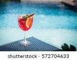 cocktail on the desk pool... | Shutterstock . vector #572704633