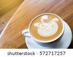 coffee latte on wooden table... | Shutterstock . vector #572717257
