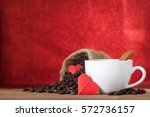 white cup of coffee with red... | Shutterstock . vector #572736157