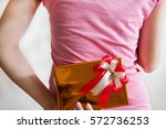 teenage girl holding gift box...   Shutterstock . vector #572736253