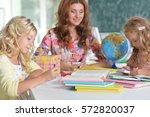 teacher with two girls  | Shutterstock . vector #572820037