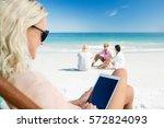 young woman using digital... | Shutterstock . vector #572824093