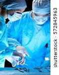 medical team performing... | Shutterstock . vector #572845963