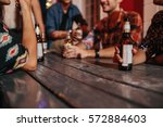 group of friends sitting around ... | Shutterstock . vector #572884603