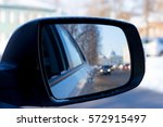 Black Side Mirror Of A Car...