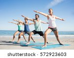 people doing yoga on the beach...   Shutterstock . vector #572923603
