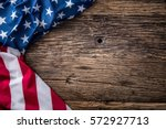 american flag on old wooden... | Shutterstock . vector #572927713