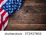 american flag on old wooden...   Shutterstock . vector #572927803