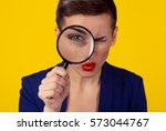 skeptical woman looking through ... | Shutterstock . vector #573044767