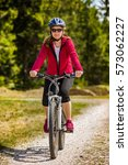 Middle Aged Woman Riding Bicycle