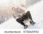 young couple sledding and... | Shutterstock . vector #573065953