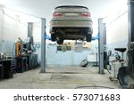car on a lift in a car repair... | Shutterstock . vector #573071683