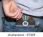 young teen boy shoplifting a cd - stock photo