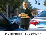 unemployed panhandler man at... | Shutterstock . vector #573104947