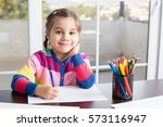 little girl is drawing picture | Shutterstock . vector #573116947