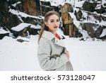 girl walking in winter forest... | Shutterstock . vector #573128047