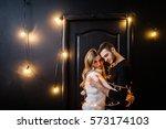 young couple in love hug each... | Shutterstock . vector #573174103