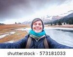 happy young woman traveler... | Shutterstock . vector #573181033