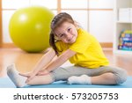 kid doing fitness exercises at... | Shutterstock . vector #573205753