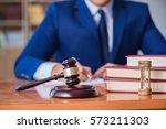handsome judge with gavel...   Shutterstock . vector #573211303
