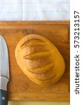 Small photo of head of traditional Adygei cheese handmade with knife on wooden Board