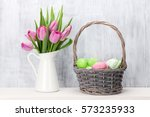 easter eggs in baasket and pink ... | Shutterstock . vector #573235933