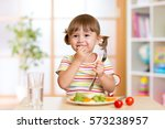 funny kid girl has a lunch in... | Shutterstock . vector #573238957