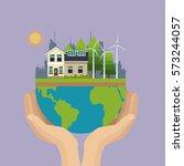 hand holding world urban wind... | Shutterstock .eps vector #573244057