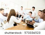young interracial business... | Shutterstock . vector #573336523