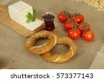 pretzel and tea | Shutterstock . vector #573377143