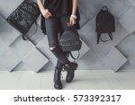 the girl holds a black backpack. | Shutterstock . vector #573392317