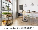 bright dining area with rack... | Shutterstock . vector #573398113