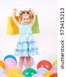 shopping child. little girl... | Shutterstock . vector #573415213