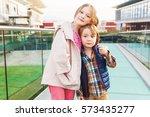 outdoor portrait of two cute...   Shutterstock . vector #573435277