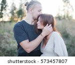 man kissing pregnant woman  | Shutterstock . vector #573457807