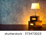 floor retro lamp on two boxes... | Shutterstock . vector #573473023