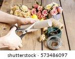 florist at work  woman making... | Shutterstock . vector #573486097
