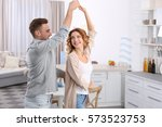 cute young couple dancing at... | Shutterstock . vector #573523753
