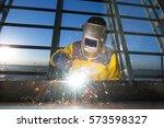worker welding metal piping... | Shutterstock . vector #573598327