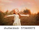 little girl spreading arms ... | Shutterstock . vector #573600073