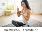woman eating healthy salad... | Shutterstock . vector #573608377
