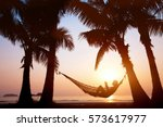 Woman Relaxing In Hammock On...