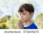 Close Up Of Boy Praying With...
