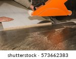 men at work sawing wood....   Shutterstock . vector #573662383