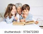 grandchildren are looking at... | Shutterstock . vector #573672283