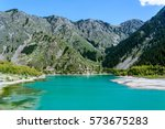 beautiful turquoise blue lake...   Shutterstock . vector #573675283