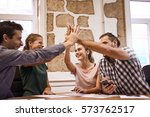 team of four young business... | Shutterstock . vector #573762517