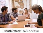 four professional millenials in ... | Shutterstock . vector #573770413